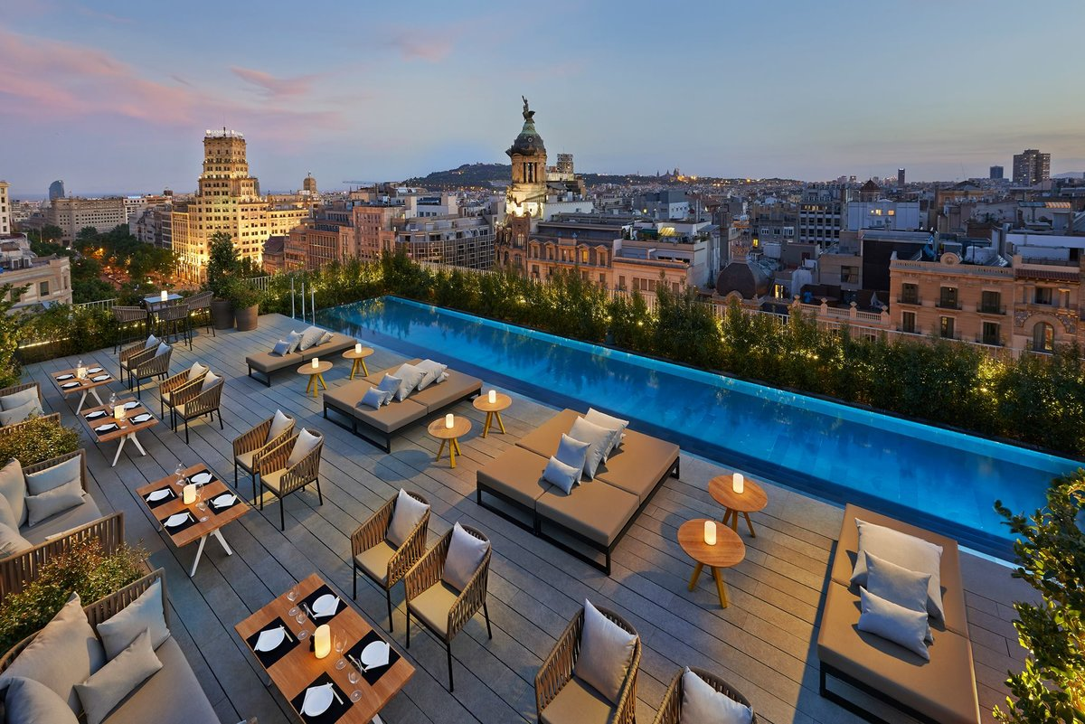 Mandarin Oriental Hotel in Passeig de Gracia is one of the most luxurious hotel in Barcelona, Spain. Rooftop terrace with swiming pool, wooden floor and furnitures for a moment of luxury in Barcelona